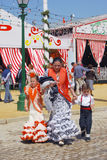 Mother and children at the Seville Fair. Royalty Free Stock Photography