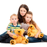 Mother with children sitting portrait Stock Photos