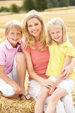 Mother And Children Sitting On Straw Bales In Harv Royalty Free Stock Photo