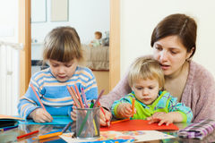 Mother and children sketching with pencils Royalty Free Stock Image