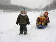Mother with children . sled. winter Royalty Free Stock Images