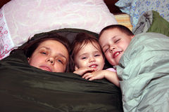 Mother and children. In the sleeping bag Stock Photography