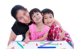 Mother and children smiling and looking at camera, over white ba Stock Image