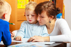 Mother and children sons drawing together Stock Photos