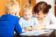 Mother and children sons drawing together Stock Photo