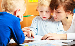 Mother and children sons drawing together Stock Image