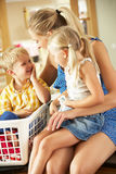 Mother And Children Sorting Laundry Stock Photography