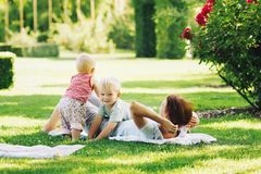 Mother with children in the summer park. Royalty Free Stock Image