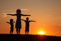 Mother and children on sunset sport training Stock Images