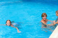 Mother with children in swimming pool. Stock Photo
