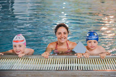 Mother and children at the swimming pool Stock Photography