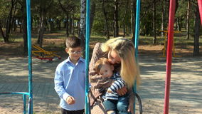 Mother and children on a swing stock video