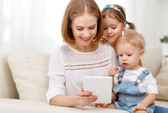 Mother and children with a tablet computer at home Stock Photography
