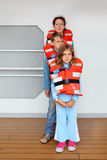 Mother, children test their life jackets Stock Images