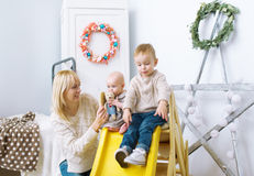 Mother with children together play in a nursery. Royalty Free Stock Photography