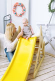 Mother with children together play in a nursery. Stock Photography