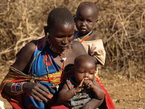 Mother with children of a tribe masai. Visit to a village masai during a safari in kenya Stock Image