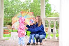 Mother with children and an umbrella in arbor Stock Photography
