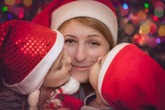 Mother and children under Christmas tree Stock Photography