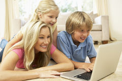 Mother And Children Using Laptop At Home Royalty Free Stock Image