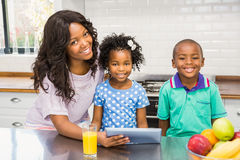 Mother and children using tablet Stock Image