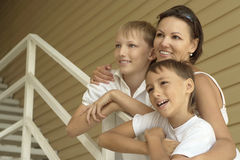 Mother and children on vacation. Portrait of a happy mother and children on vacation Royalty Free Stock Photo