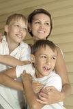 Mother and children on vacation. Portrait of a happy mother and children on vacation Stock Photos