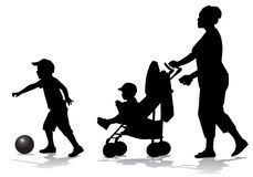 Mother with children on walk. Mother walks with the kids and a stroller for a walk Stock Images
