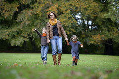 Mother and children walking in the park Stock Photo