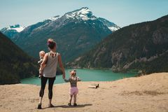 Mother and Children Walks Near Body of Water royalty free stock photo