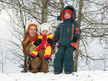 Mother with children. winter. Trees stock images