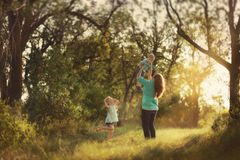 Mother with children in the woods Stock Photography