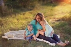 Mother with children in the woods Royalty Free Stock Photography