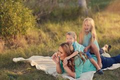 Mother with children in the woods Royalty Free Stock Photo