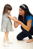 Mother cleaning wound to her daughter Royalty Free Stock Image