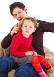 Mother combing daughter's hair Royalty Free Stock Images