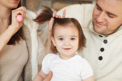 Mother combing her baby's hair royalty free stock photo