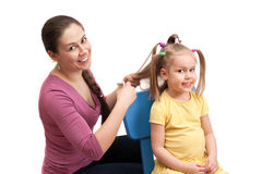 Mother is combing a little girl Stock Photography