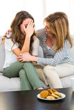 Mother comfort her daughter Stock Images