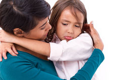 Mother comforting, caring her daughter in unhappy, sad, negative Royalty Free Stock Image
