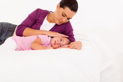 Mother comforting crying baby stock images