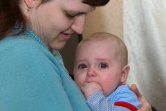 Mother comforting crying baby Royalty Free Stock Photo