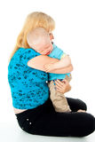 Mother comforting a crying child. Mother comforting a crying baby in her arms Stock Photo