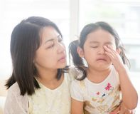 Mother comforts crying daughter. Royalty Free Stock Photos