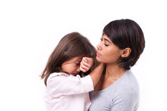 Mother comforting crying daughter, family problem solution Stock Photography