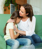 Mother comforting crying  daughter. At home Royalty Free Stock Photography
