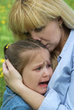 Mother comforting crying daughter Stock Photography