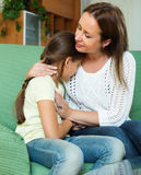 Mother comforting crying little daughter Stock Photo