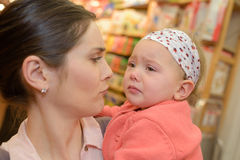 Mother comforting crying little girl. Mother comforting her crying little girl Stock Images