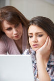 Mother Comforting Daughter Being Bullied Online Stock Photo